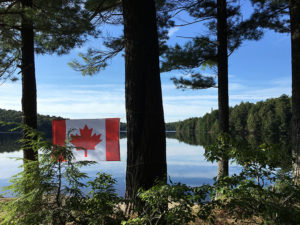 Canada flag hanging at the back of my campsite on Linda Lake