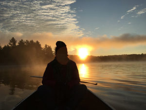Watching the sunrise from the water while paddling on Clydegale Lake