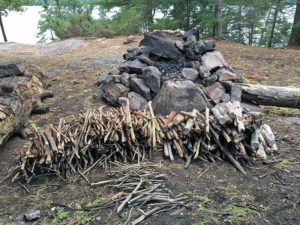Large pile of fire wood on a cold night in Algonquin Park