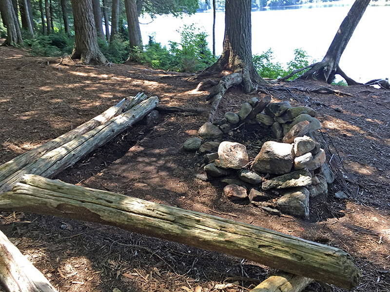 Queer Lake campsite #5 fire pit and seating area