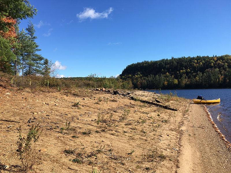 Scorch Lake campsite #2 long sandy beach for canoe landing