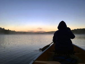 Watching the sunset on David Lake while paddling in a canoe
