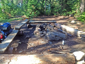 Fire pit and seating area of my campsite on Little Otterslide Lake