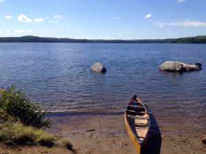 Solo canoe at the portage leading into Burnt Island Lake