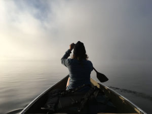 Paddling on Smoke Lake in Algonquin Park through thick fog