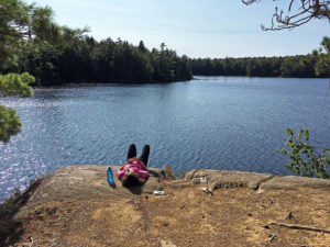 Suntanning and relaxing on the cliff shoreline of our campsite on Bonnechere Lake