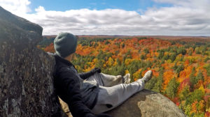 Sitting at the Skymount Lookout overlooking the view of fall colours in Algonquin Park