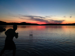 Skipping rocks on Three Mile during the sunset