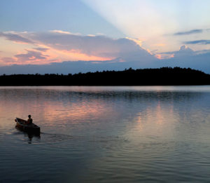 Solo paddling during the sunset on Maple Lake