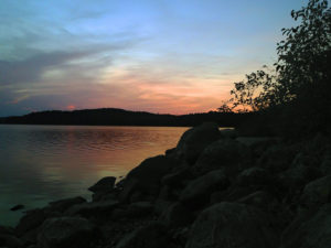 Sunset on Manitou Lake from the rocky shoreline of our island campsite