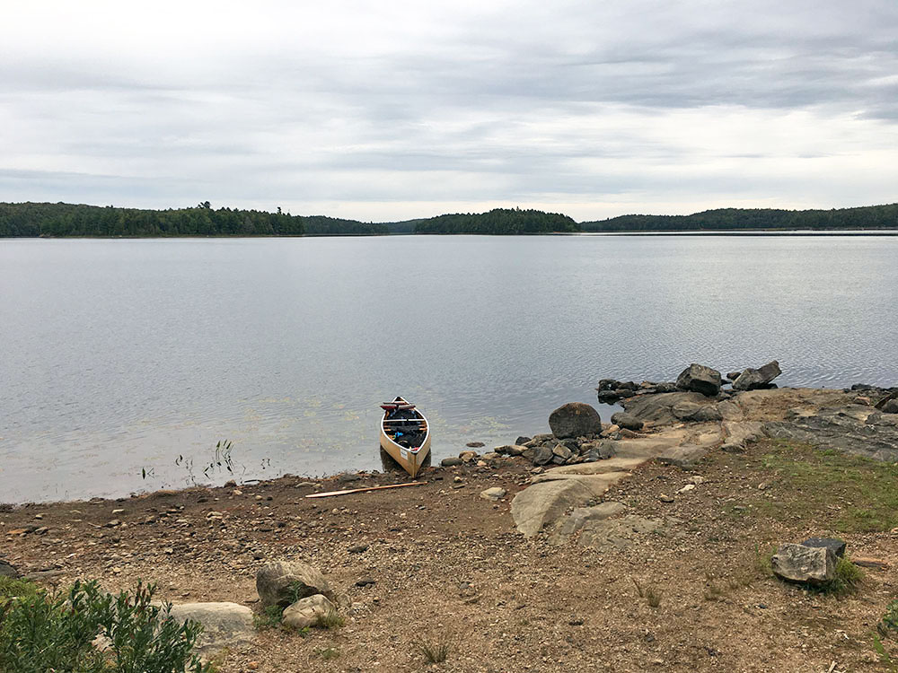 Rocky beach landing of island campsite on Misty Lake