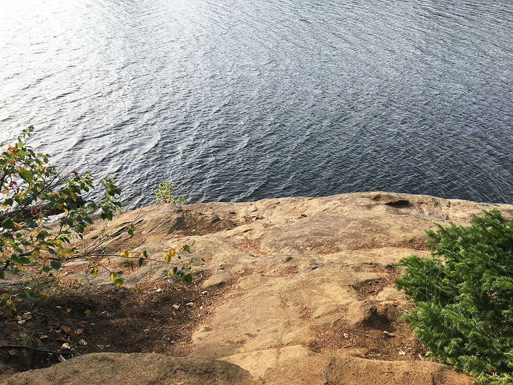 Looking down the cliffs toward the water on Misty Lake