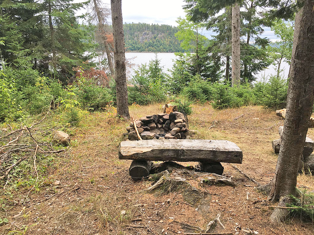 Fire pit and seating of campsite #1 on White Trout Lake