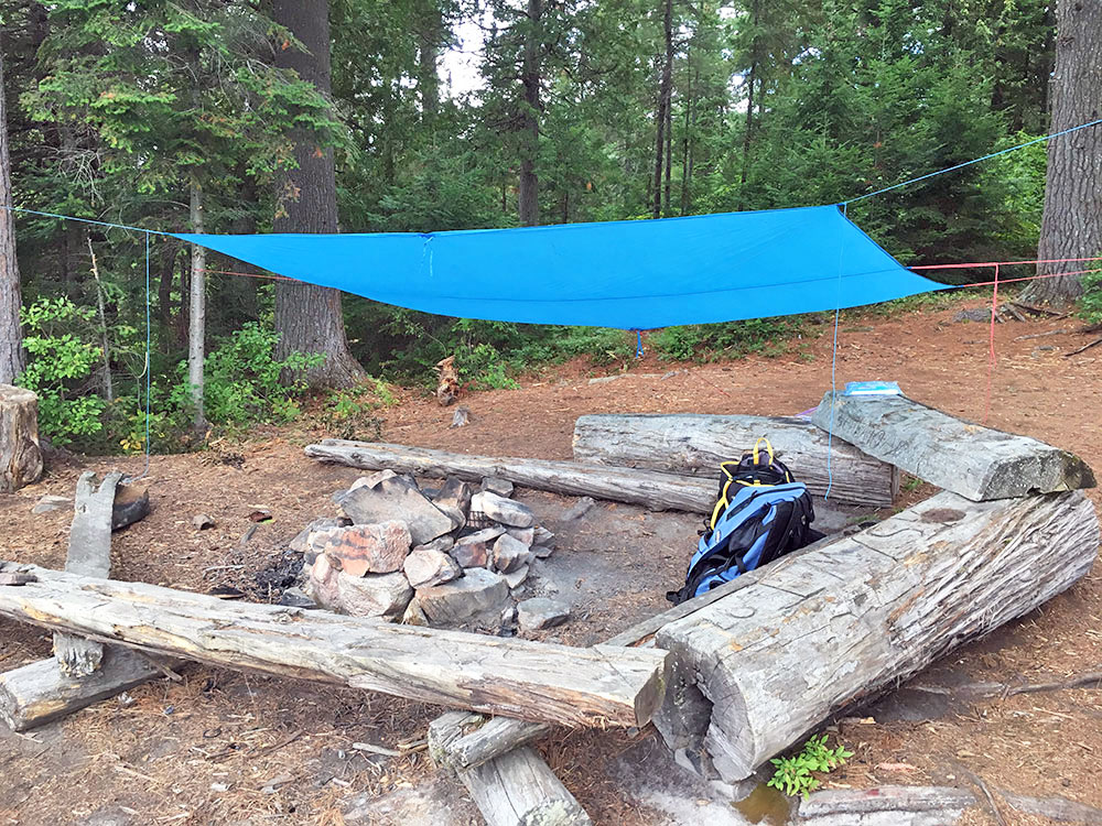 Fire pit and seating area of campsite #7 on White Trout lake