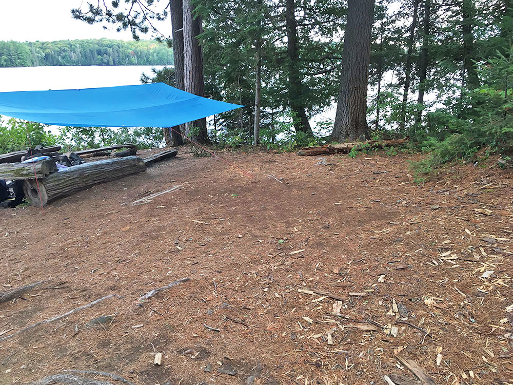 Tent spot behind fire pit on White Trout Lake