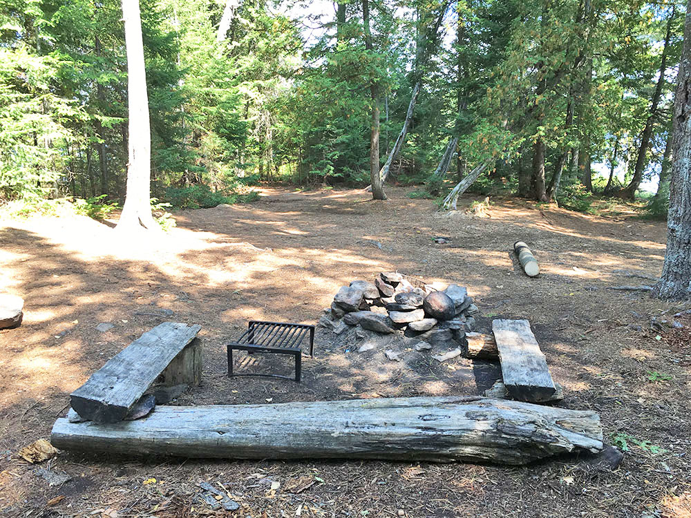 Interior fire pit and seating area at McIntosh Lake campsite #10