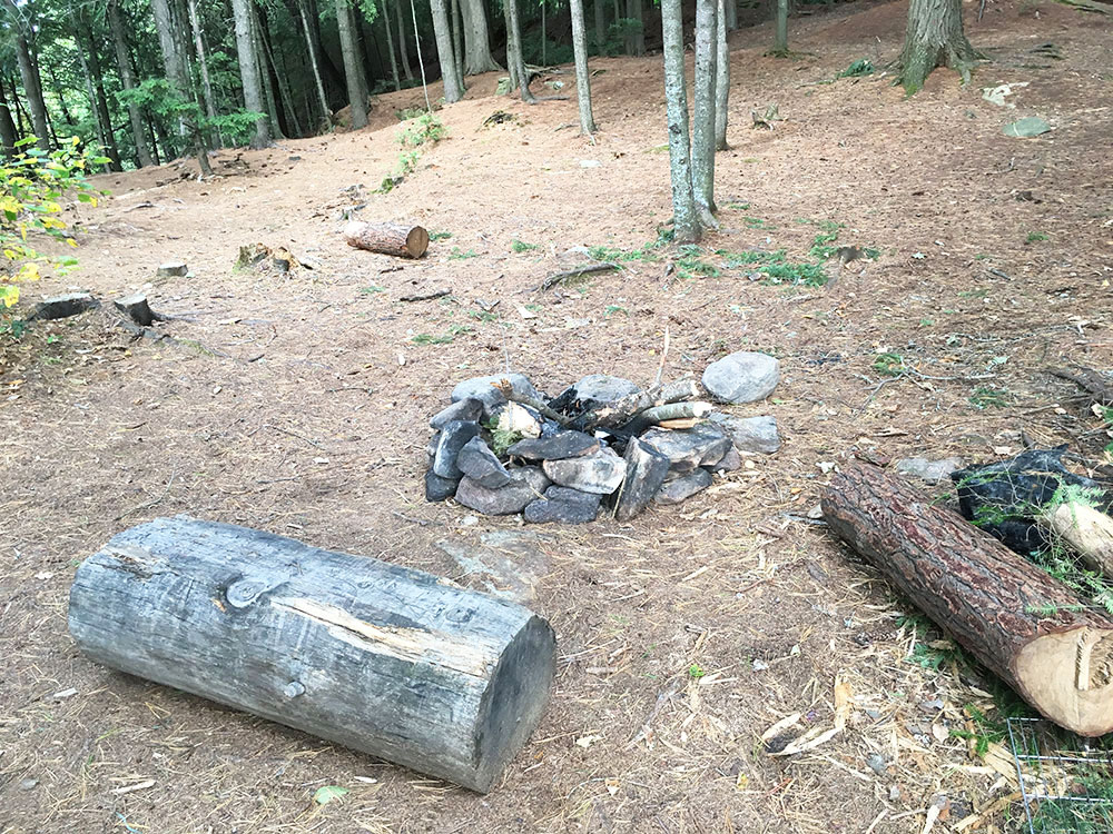 Secondary fire pit inland on McIntosh Lake campsite #17