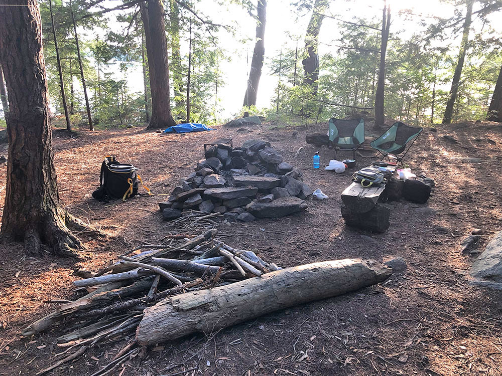 Fire pit and seating area of campsite #15 on Lake Louisa