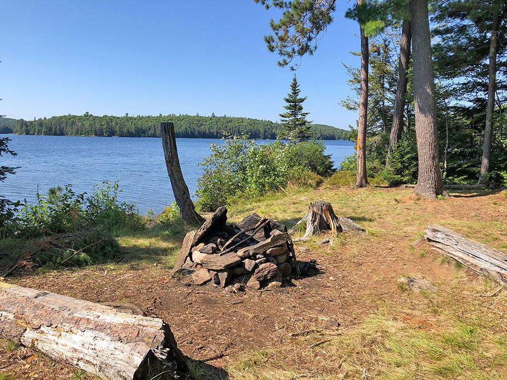 Fire pit and seating on Lake Louisa campsite