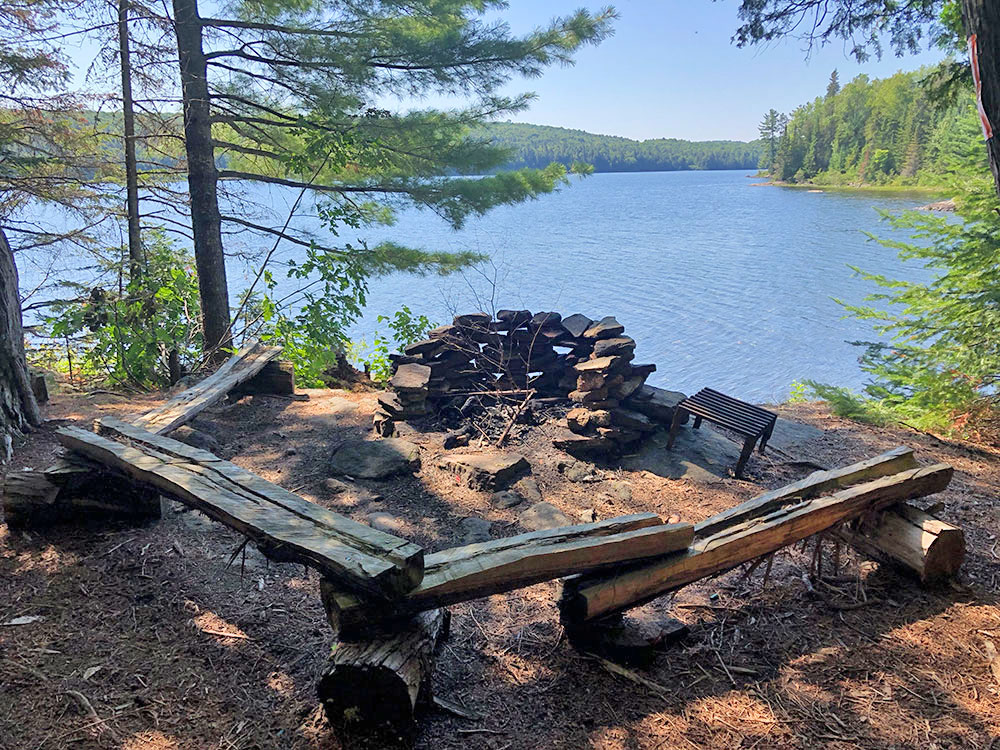 Fire pit and seating area for campsite #5 on Lake Louisa
