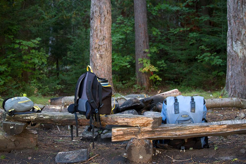Food barrel and canoe pack on Little Otterslide Lake campsite