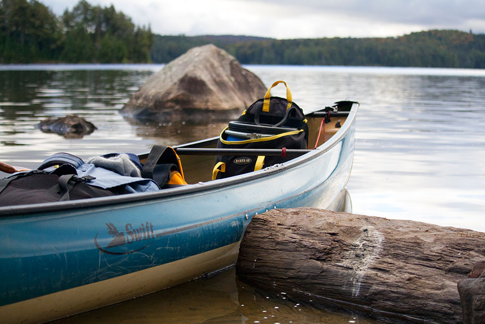 Loaded canoe ready to launch onto Burnt Island Lake in Algonquin
