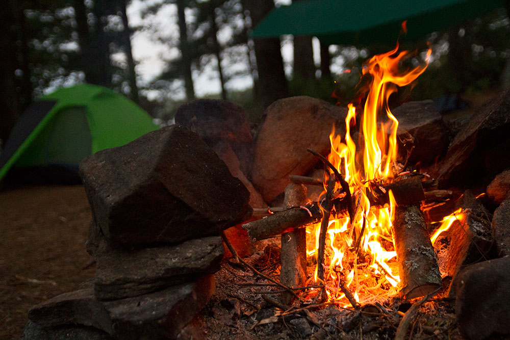 Morning fire to keep warm on island campsite on Big Trout Lake