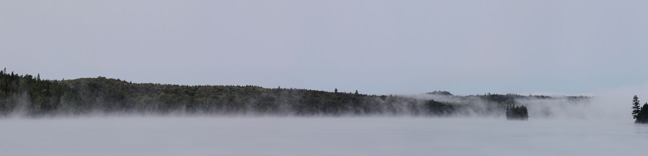 Panorama of Big Trout Lake during a very cold and misty morning in September