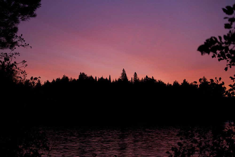 Red and purple sunrise colours on Burntroot Lake Anchor Island