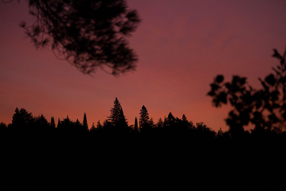 Dark red sunrise from Burntroot Lake in Algonquin Park