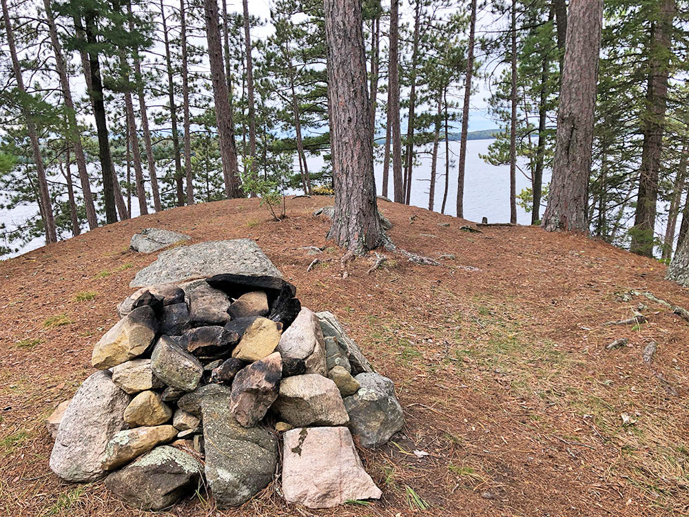 Fire pit on west side of the island on campsite #11 on Big Trout Lake