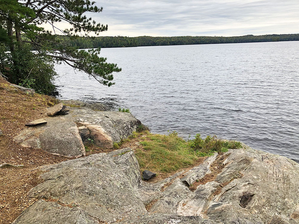Rocky shoreline at the west end of the island campsite #11 on Big Trout Lake