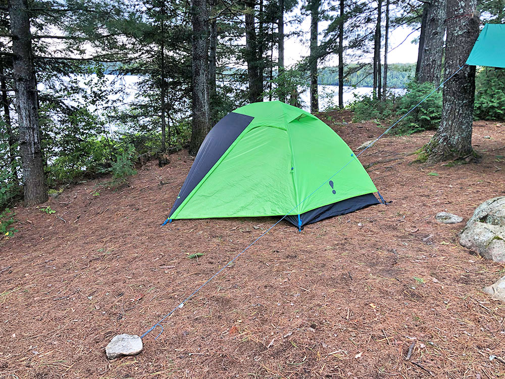 Green Eureka Suma 2 tent pitched on campsite #11 on Big Trout Lake in Algonquin Park