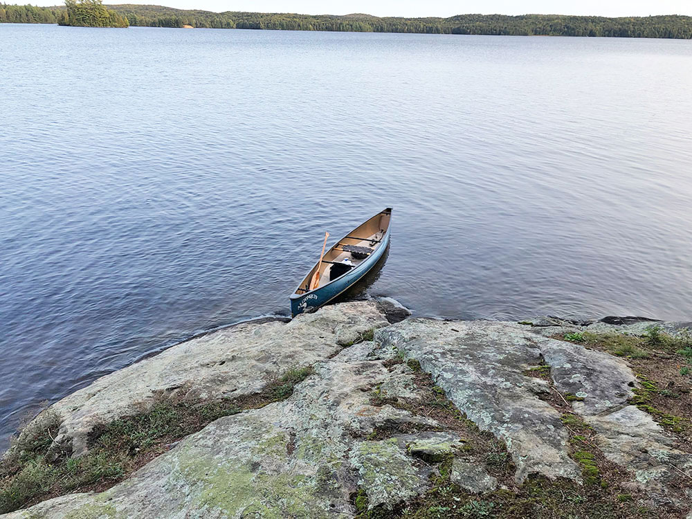Large rock by the shoreline of the canoe landing on Campsite #14 on Big Trout Lake