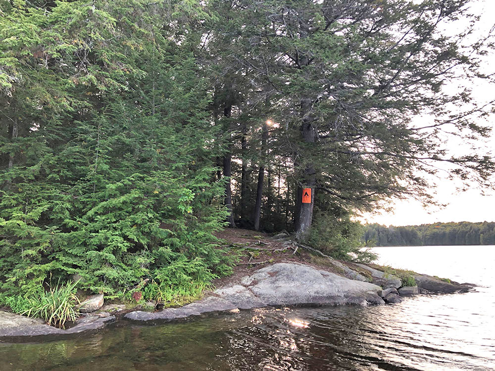 View of the rocky canoe landing on Campsite #15 on Big Trout Lake from the water