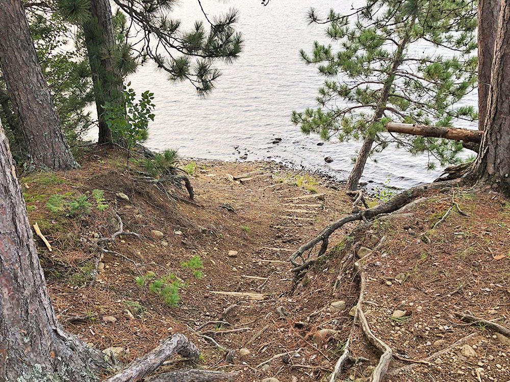 Looking down at the staircase leading from the water to the top of campsite 4 on Big Trout Lake