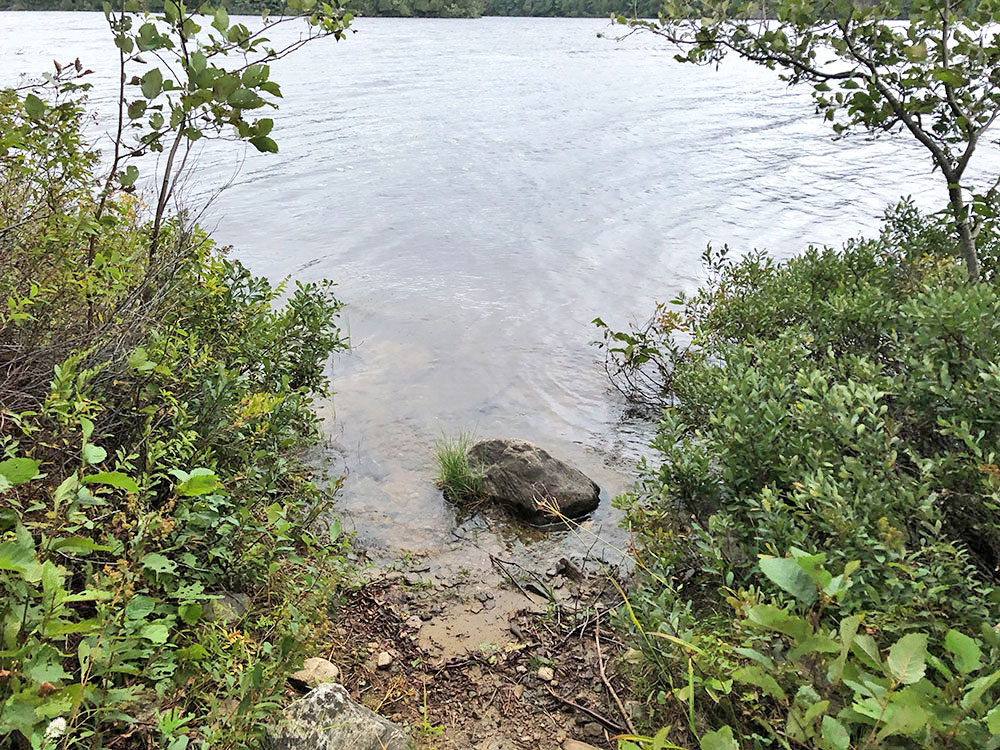 Small canoe landing with rock blocking entry on Anchor Island