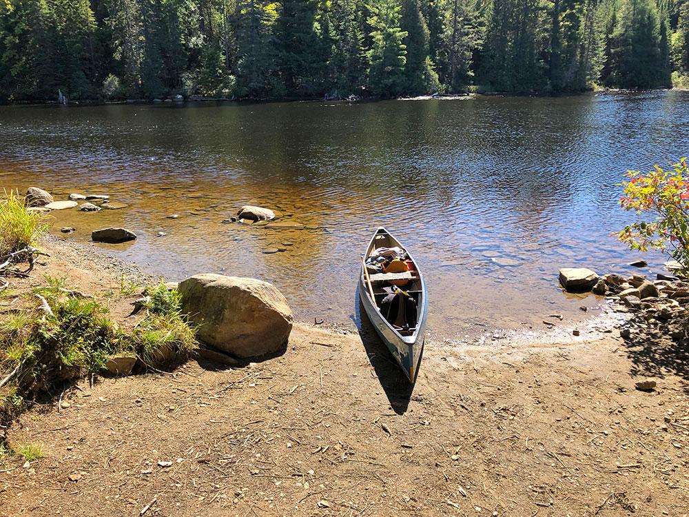 Large sandy canoe landing on Joe Lake's east arm campsite