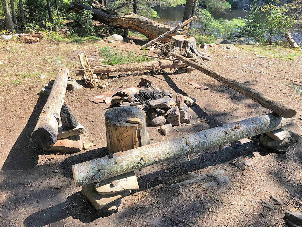 Fire pit and seating area of campsite 5 on Joe Lake's east arm