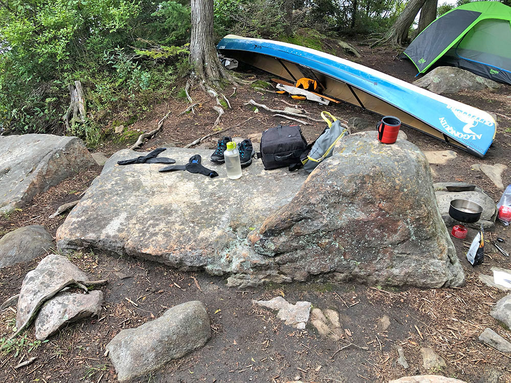 Large rock to organize gear or food prep on Otterslide Lake island campsite in Algonquin Park