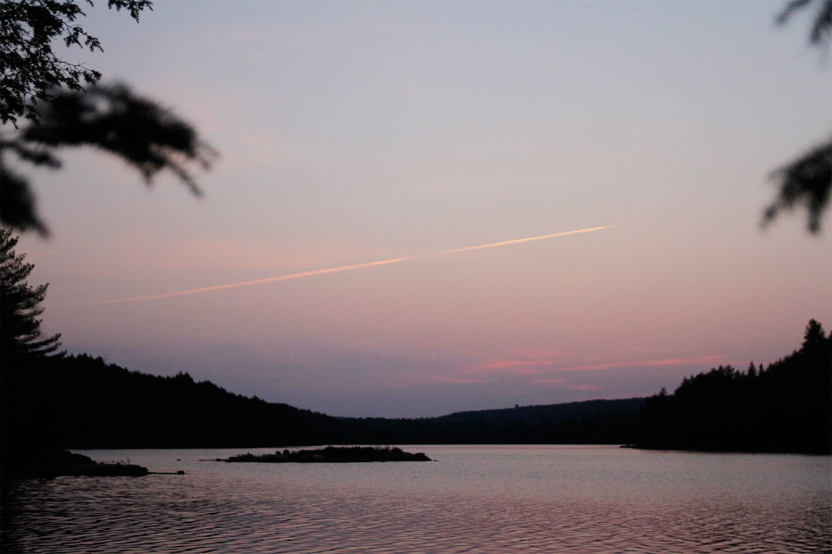 Early sunrise with colourful sky on Ragged Lake in October 2020