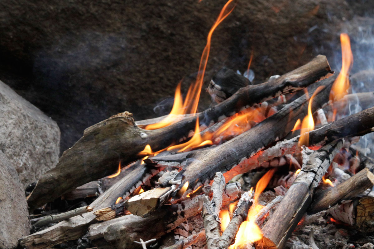Fire getting started on Ragged Lake campsite in Algonquin Park