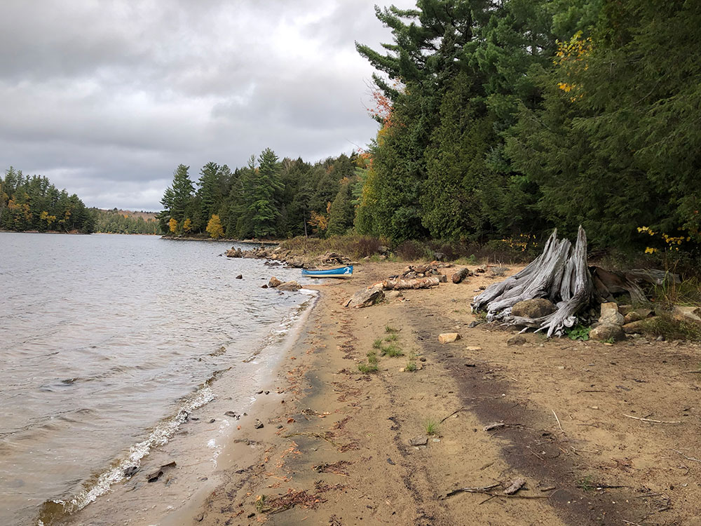 Large beach area on the west side of campsite #15 on Ragged Lake