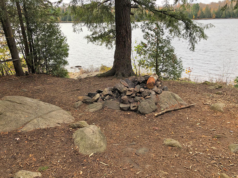 Fire pit without any seating on Ragged Lake campsite #15