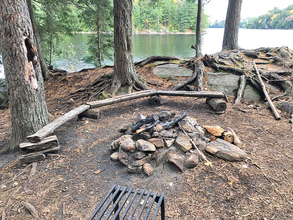Fire pit and seating area on Ragged Lake campsite #20 in Algonquin Park