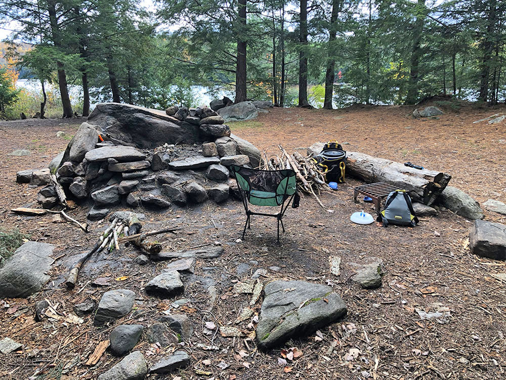 Fire pit and seating area on Ragged Lake campsite #3 in Algonquin Park