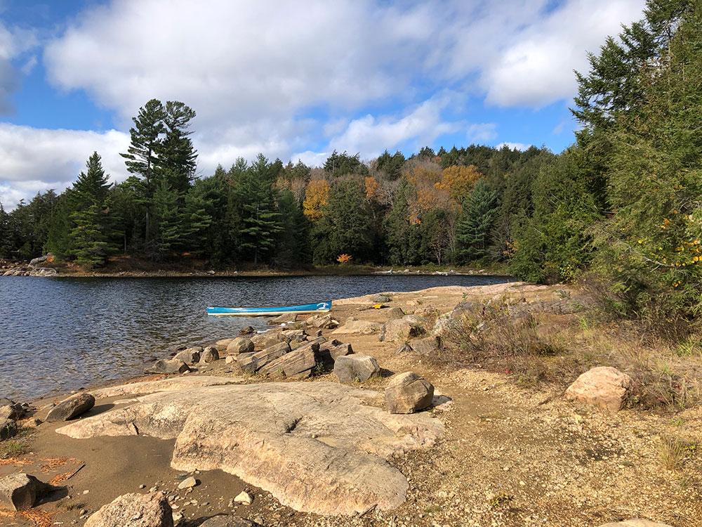 Western rocky shoreline on Ragged Lake campsite #3