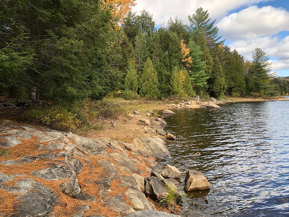 Eastern rocky shoreline on Ragged Lake Campsite #3