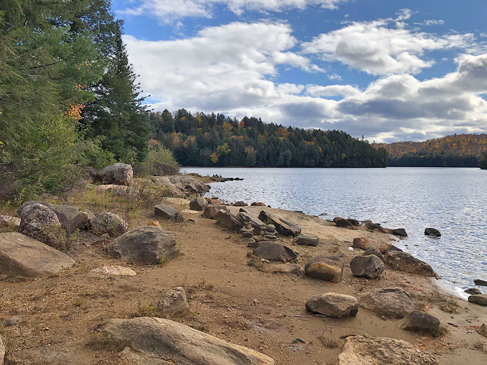 Beach and rocky shoreline on the west side of Ragged Lake campsite #3