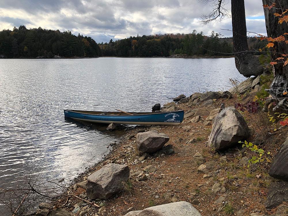 Canoe landing with blue Keewaydin Canoe on Ragged Lake campsite #9